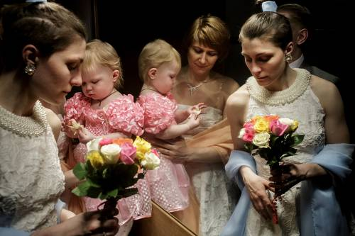 Polina Popova in her wedding dress with her soon-to-be wife Irina Sinoveva and their little girl Ksenia. Same-sex marriages are not possible, nor legally acknowledge in Russia, so the lesbian couple have travelled from their hometown St. Petersburg to Copenhagen, Denmark where it's been legal since 2012. As of 1 January 2015, only seventeen countries in the world allows same-sex marriages.