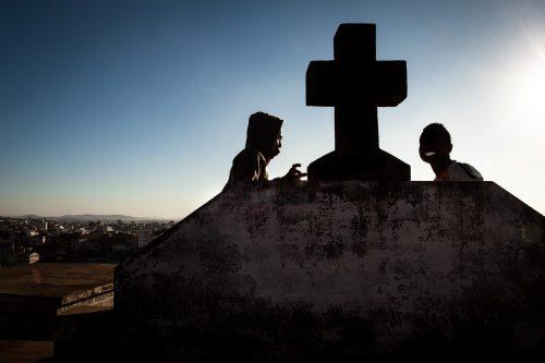 Smoking weed during at sunset. Anjanahary cemetery, Antananarivo, Madagascar.
